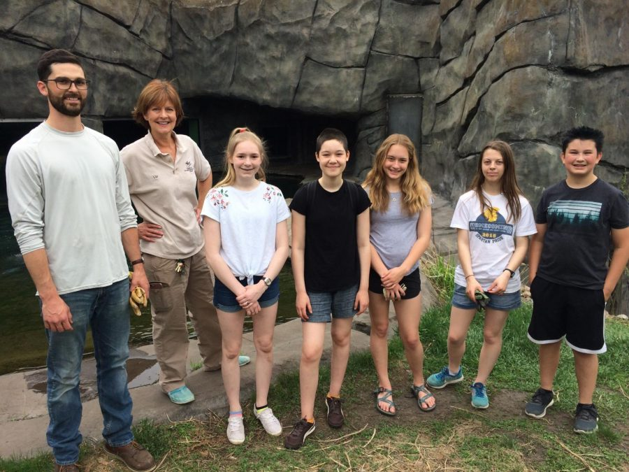 NO PLACE LIKE THE ZOO. PAWS members pose in the zoo enclosure they helped clean in preparation for spring.