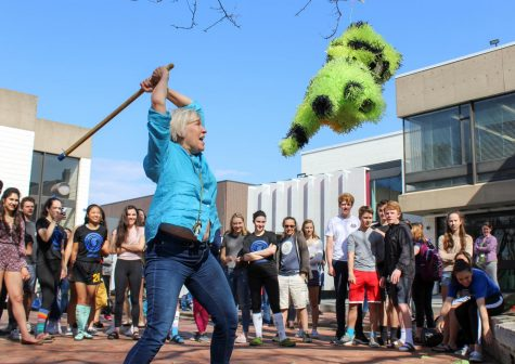 US Spanish teacher Pam Starkey readies an overhead blow on the piñata.