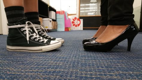 Whether or not high heeled shoes will damage the lunch room floor is a key issue in the debate.