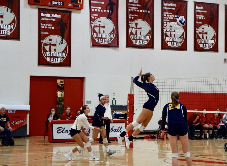 Senior and captain Blythe Rients gets a kill off of a backrow attack in the Girls Varsity Volleyball game against Visitation on Sept. 21.