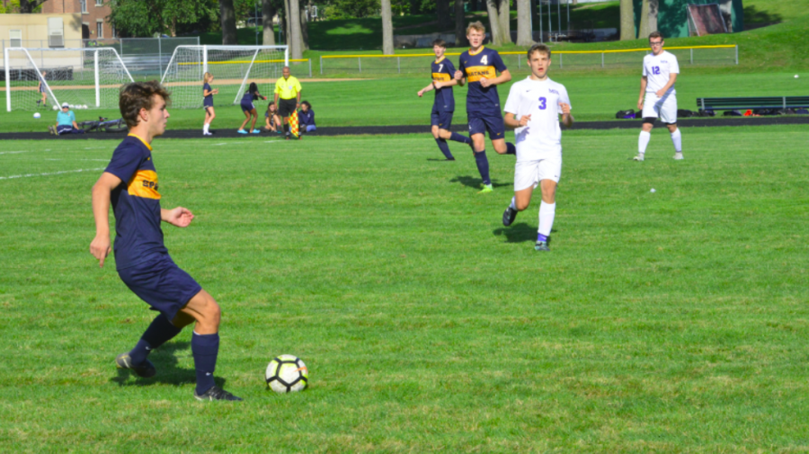 Junior Thomas Bagnoli gains control of the ball in the first half of the game.