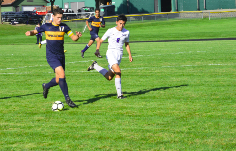 Senior Eric Lagos dribbles the ball up the field. He scored twice in the game.