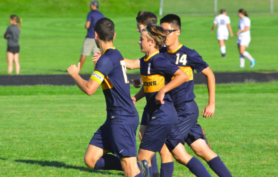Team mates celebrate after Eric Lagos scores his first goal.