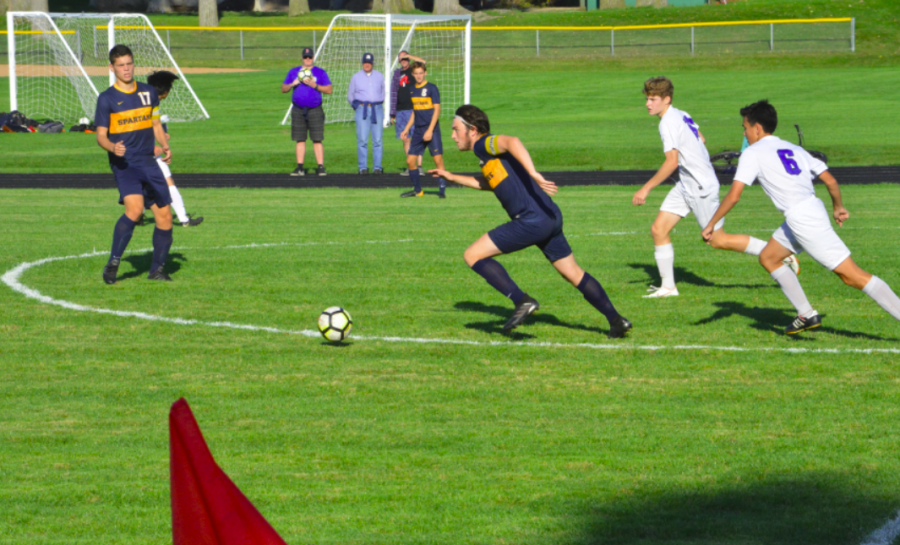 Michael Forsgren takes the ball to the goal during the second half.