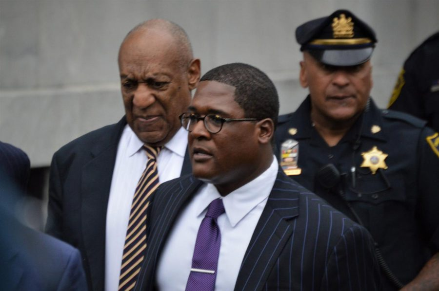 Cosby leaves the courthouse during a trial day this summer.