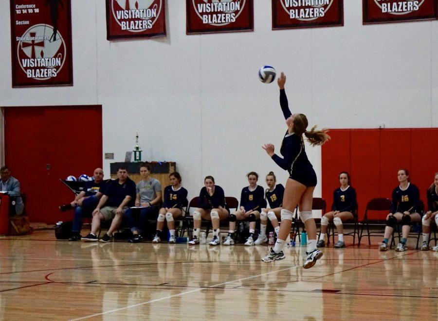 Junior Sydney Therien serves a jump serve against Visitation.