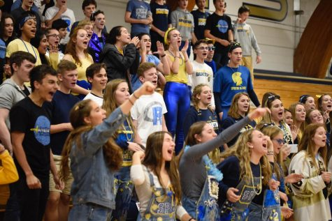 Seniors rise on their feet, in a show of Spartan Spirit.