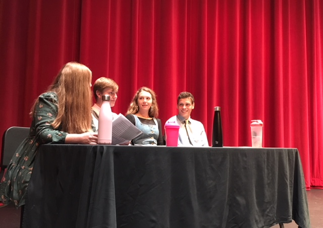 Muriel Lang (third from left) waits with other senior speakers Ellie Nowakowski, Garrett Small, and Eric Lagos at the beginning of the first senior speech assembly on Sept. 14.
