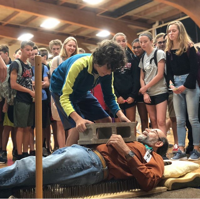 Dr. Heilig performs his famous 'bed of nails' demonstration at the Science Alliance booth.