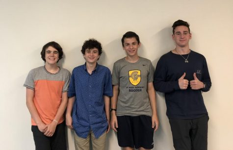 Senior Reuben Vizelman and his mentees, 9th graders Nathan Mann, Griffin Moore, and Alexander Moore, pose for a photo.