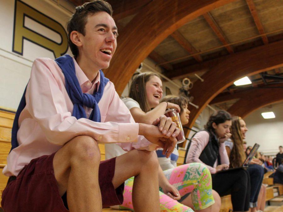 Senior Sawyer Johnson smiles as he observes the homecoming dodgeball tournament.