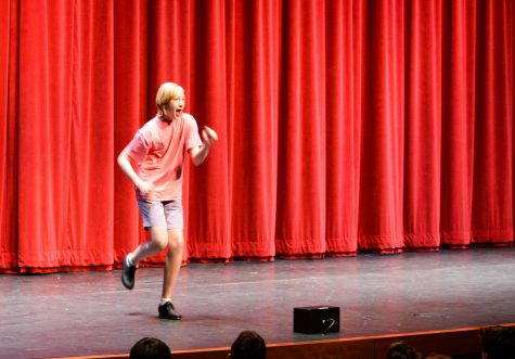 Sophomore Rylan Hefner tap dances in front of the upper school while lip syncing.