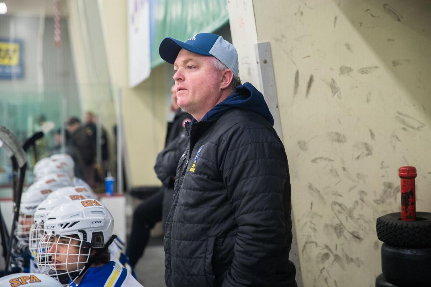 """Eddie Wynne coaching the 2017-18 team from the bench. He will be back to coaching from the bench this year, this time as head coach """"There's a lot of comradery, and chemistry with him being back"""" - Julie Friend."""