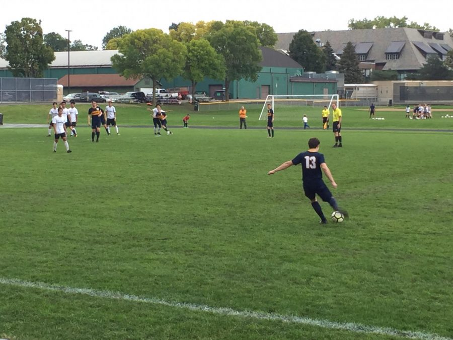 Sophomore Jackson Biggs sends the ball towards the opponents goal on a free kick.