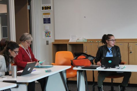 US Math Teacher Mary Lincoln, US English Teacher Kristen Collier, and Senior and President of People for Environmental Protection, Iris Shaker-Check, have a weekly meeting to catch up on their current projects.