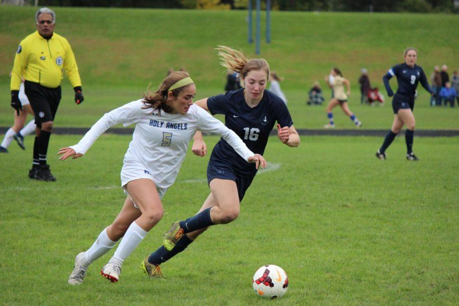 Sophomore Julia Scott chases the ball.
