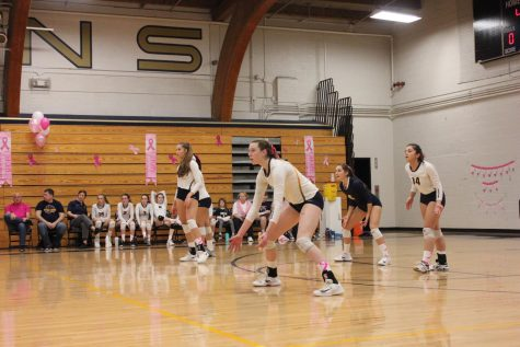 Junior Audrey Egly and seniors Blythe Rients, Mia Litman, and Mimi Geller wait for the other team to serve the ball.