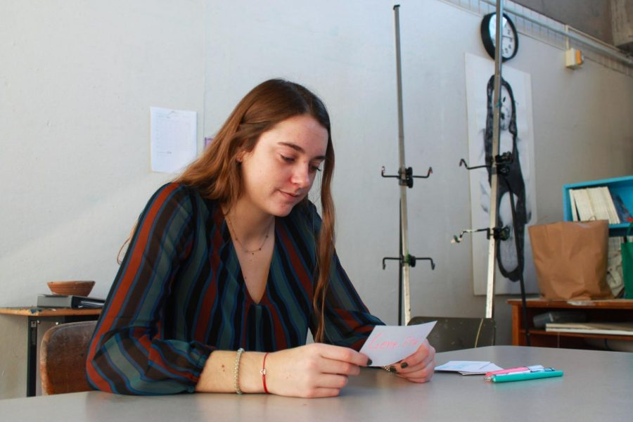 Senior Janie Brunell uses flash cards to study.