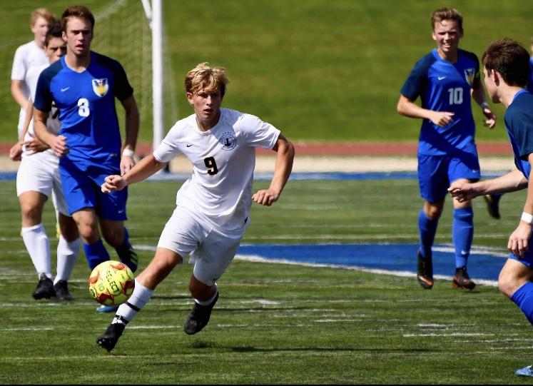 Senior Adam Zukowski looks to move the ball and create a scoring opportunity.