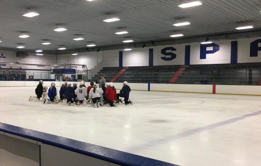United team hits the ice to prepare to skate with their new coach for the first time.