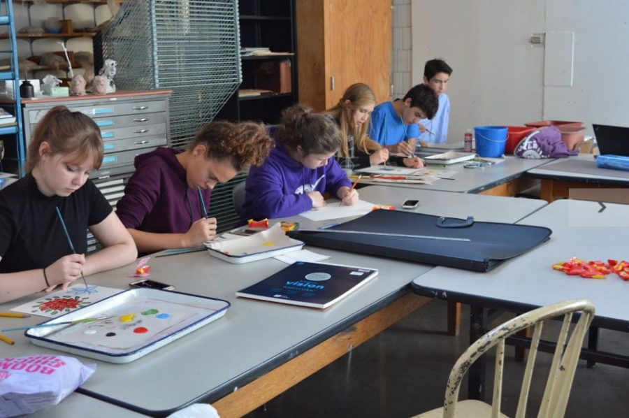 Students hard at work during painting party.
