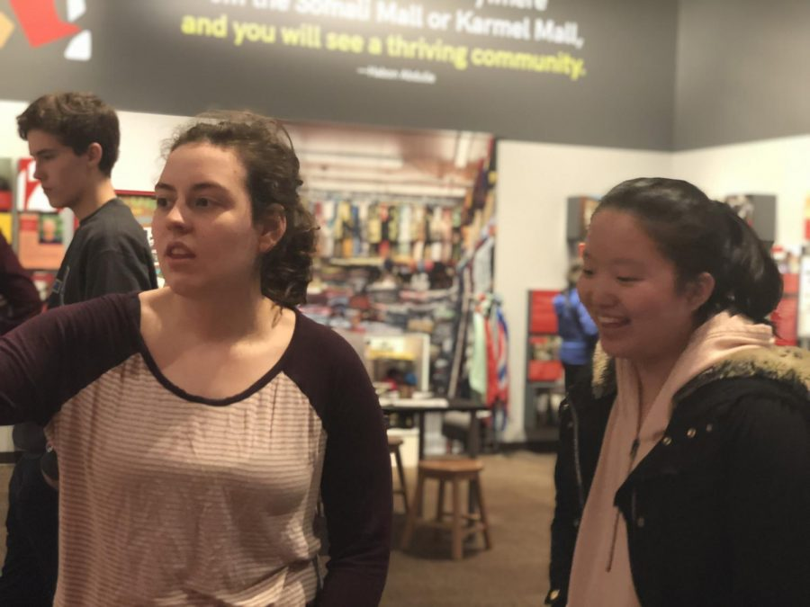 Seniors Kayla Edmundson and Annie Lam read a personal story at the