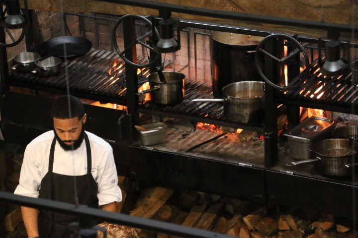 In Bloom features fire-made culinary dishes served fresh.