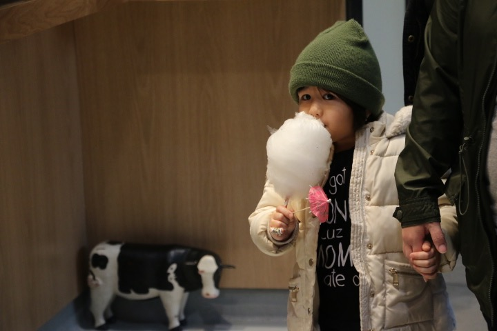 A girl enjoys her cotton candy from Spinning Wylde at Keg and Case Seventh Street Market.