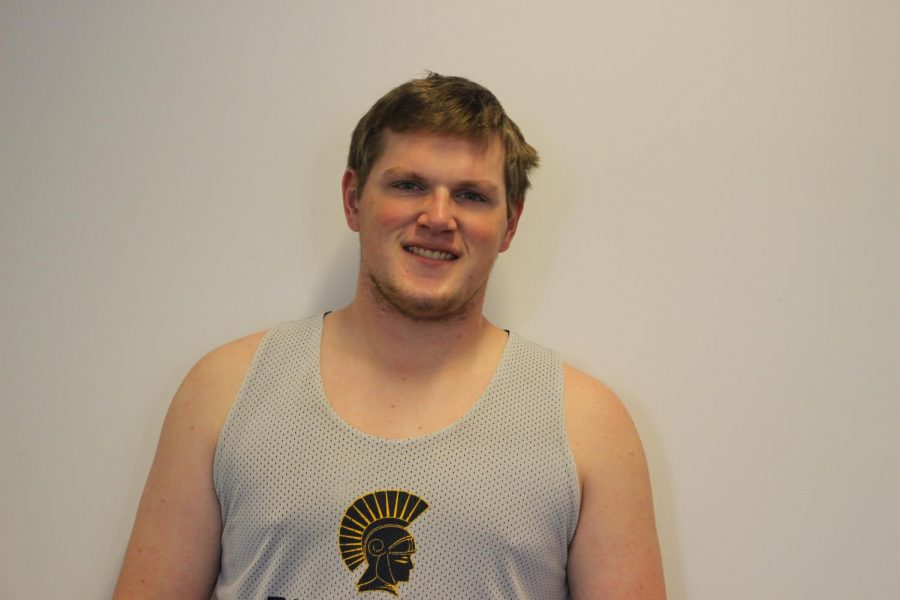 """As a member of the boys varsity basketball team for three years now, the feeling of dribbling a basketball has become second nature. Senior Ryan Moore is the captain of the team and is excited to see what the new season holds.   """"Our goals for the past few years haven't changed much. Definitely to just get better and to be playing really good basketball by the end of the season. I think [our goals] will probably uphold, because we're already starting to play pretty well so I'm looking forward to seeing how far we'll be able to go,"""" Moore said.   Moore has been able to get comfortable in the defensive position, as he has stayed in the same position ever since he started playing basketball in fifth grade. Moore has also quickly picked up on the responsibilities that come with being in a solidified position of leadership.   """"In terms of actual positions, I'm a center. I play defense and do a lot of help defense in the lane. And in terms of the team dynamic, I'm a captain. So I'm one of the leaders, and I'm as a senior this is my third year on varsity, so I kinda know the drill,"""" Moore said."""