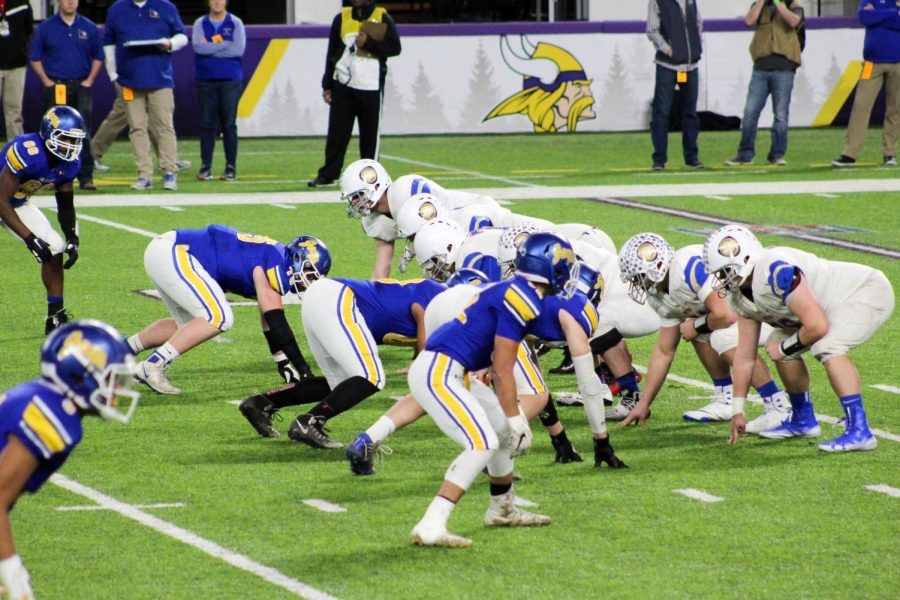 Wolfpack and Waseca stare each other down before the play.
