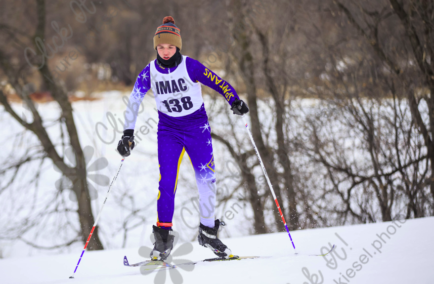 Matt Pauley skis across the course during a meet.