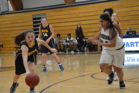 Sophomore Jane Christakos dribbles the ball.