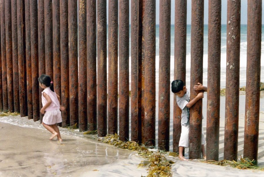 Children play on the border fence in Tijuana, Mexico.