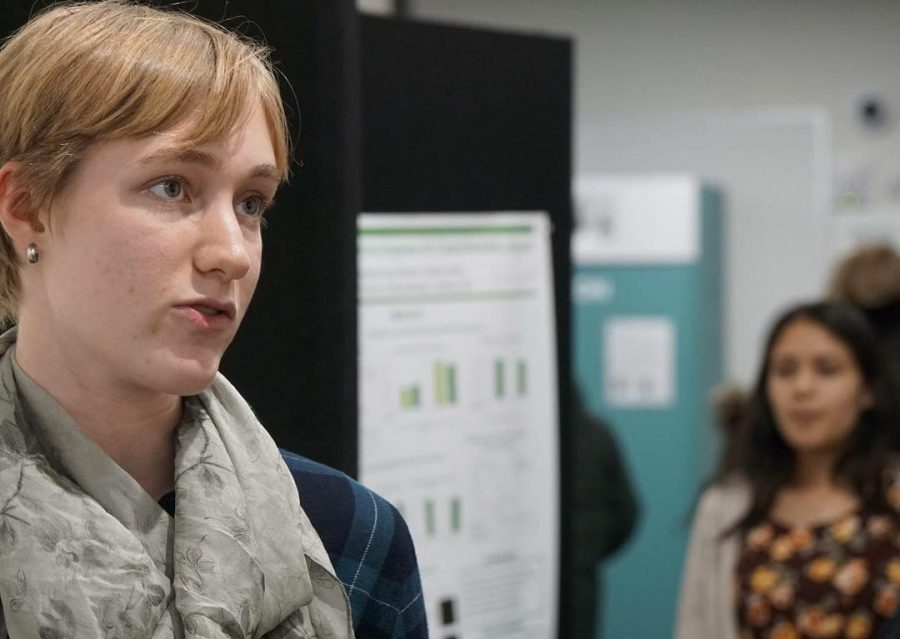 """Senior Maggie Hlavka focused on the effects of climate change in her ASR project. """"In short what I found was that the growth of these two plants, babe lust, and Canada rye, which are common tallgrass prairie plants, are not affected by drought conditions or variable precipitation which is a result of climate change in North America,"""
