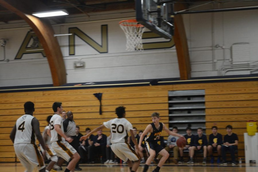 Sophomore Adam Holod secures his possession of the ball.