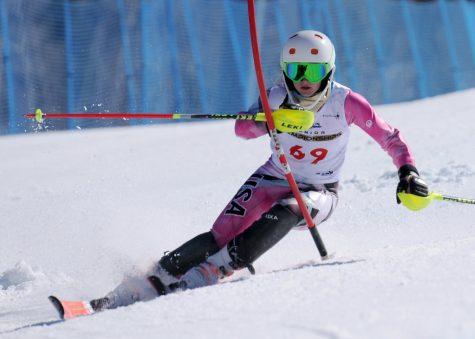 Senior Bailey Donovan skis down a course.
