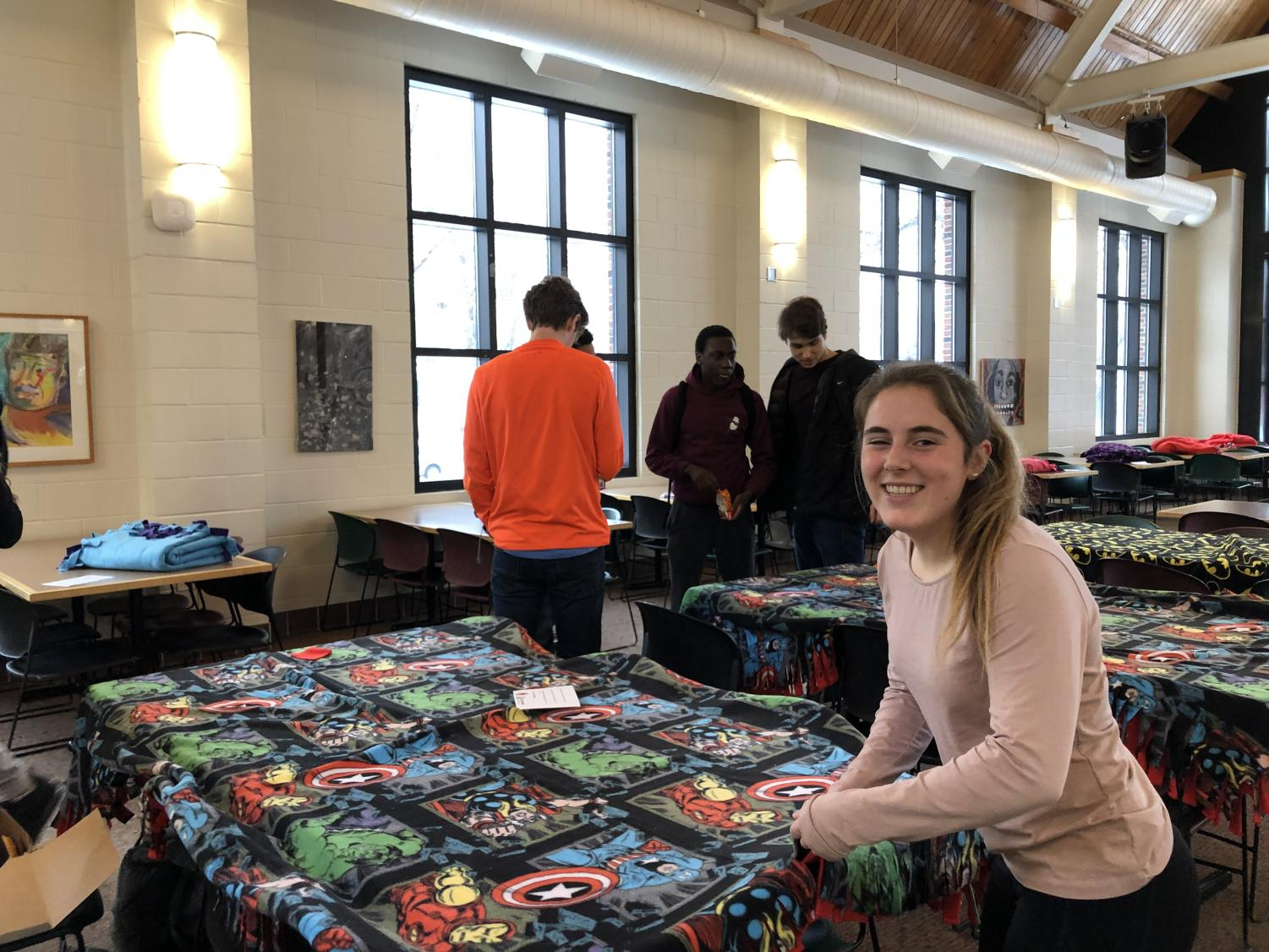 Senior Tessah green works on a tie-blanket for the My Very Own Bed organization.