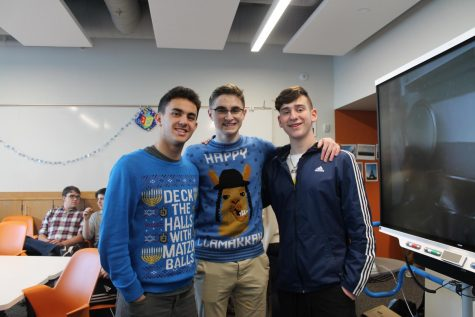 Seniors Ethan Less, Shane Litman and  Reuben Vizelman wear Hanukkah-themes sweaters.