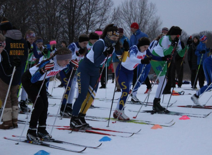 Skiers line up, ready to go