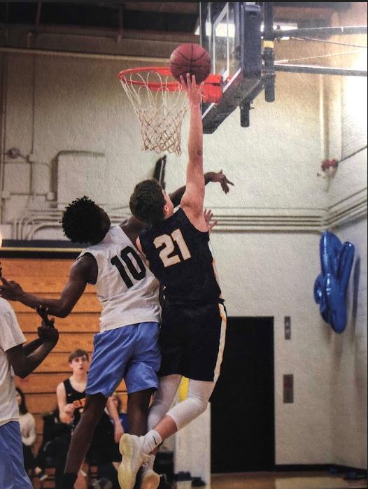 Senior Will Christakos rises to get a rebound.