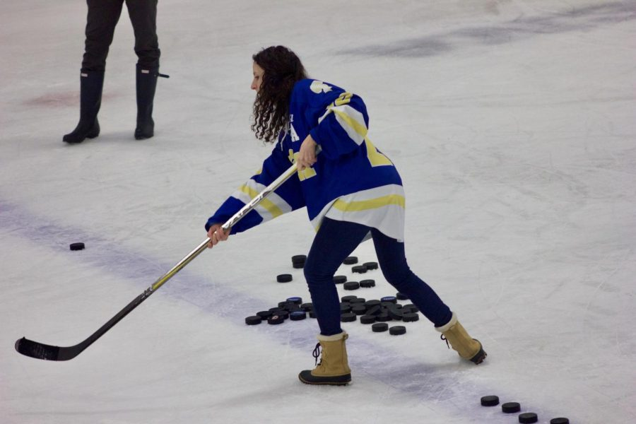 US Fitness teacher Cari Jo Anderson shoots the puck in the teacher shooting challenge on Jan. 22.