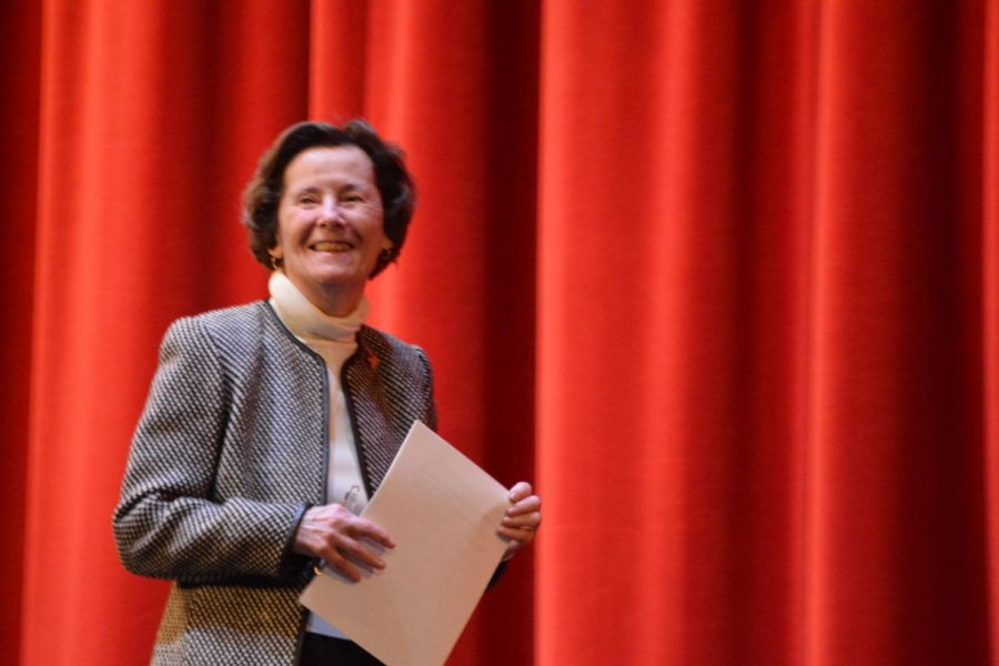 """Ruth Huss '57 listens to applause from students and faculty before her speech to the school. """"I'm standing here today in this beautiful facility and am thankful to this very school which helped me form the foundation of my life,"""" Huss said."""
