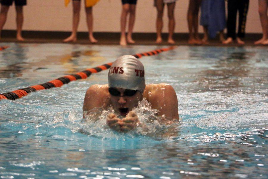 Junior Cesar Gallagher swims the 200 IM.