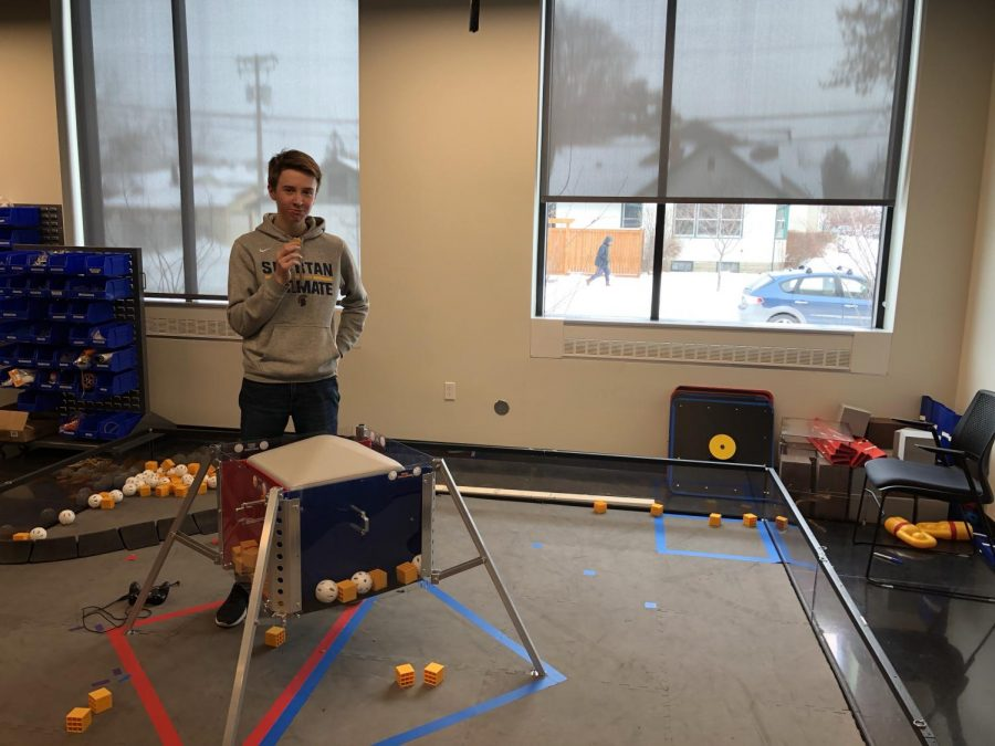 Sophomore John Hall stands in the Robotics room where the team practices using their robot.