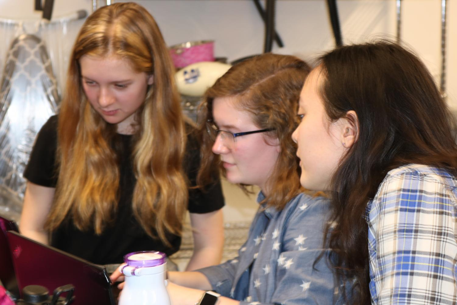 Seniors Lily Nestor and Gemma Yoo, and 9th grader Sophie Cullen discuss Science Olympiad plans.