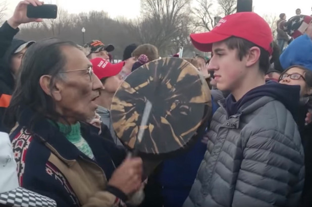 Confrontation between Nick Sandmann and Nathan Phillips.