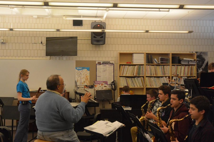 Director of Band Bill Mayson conducts a group of students in the jazz band.