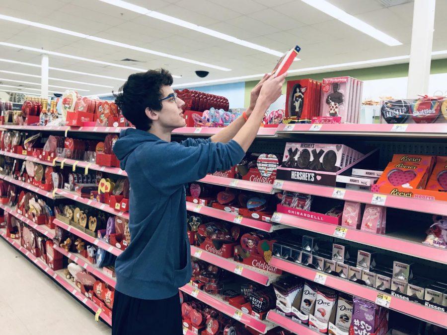 Junior Ryan Strobel examines Valentine's Day products at Walgreens on Randolph Ave.