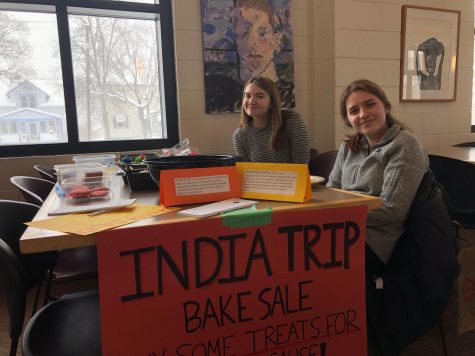 Senior Gabby Harmoning and sophomore Maxanne Millerhaller sell baked goods to the SPA community during lunch.
