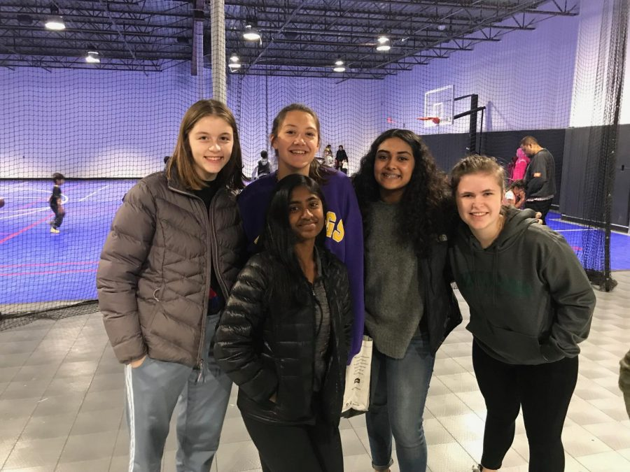 Sophomores Lynn Reynolds, Annika Rock, Rashmi Raveendran, Aman Rahman and Elaina Parsons pose for a picture while volunteering at the food shelf.